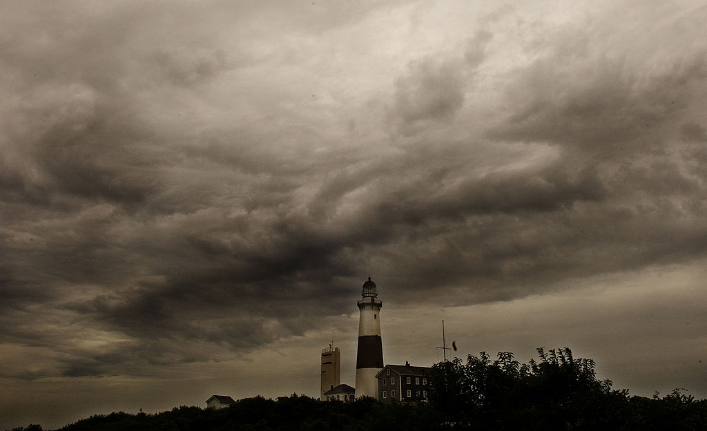 Storm clouds loom over the Montauk lighthouse as hurricane Irene makes its way up the East coast on August 27, 2011 in Montauk, New York. At least three people have died in storm-related incidents since Hurricane Irene slammed into the US east coast on Saturday, officials said.        AFP PHOTO/STEPHEN CHERNIN (Photo credit should read STEPHEN CHERNIN/AFP via Getty Images)